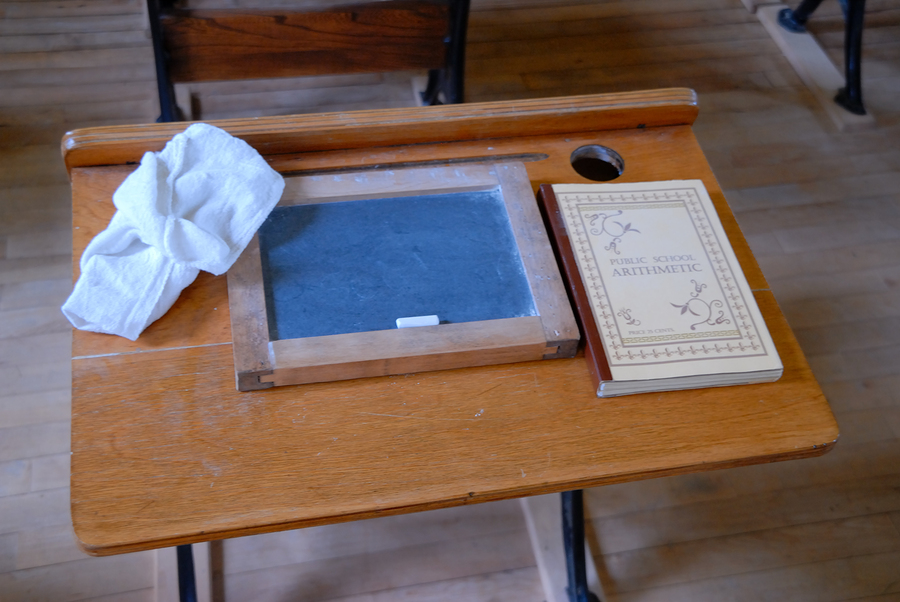 An old country school desk and slate and primer